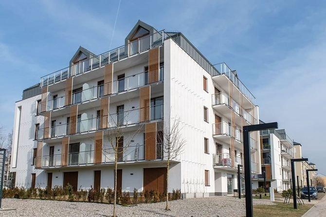 Nowe podejście do określania minimalnej izolacyjności akustycznej przegród zewnętrznych budynków