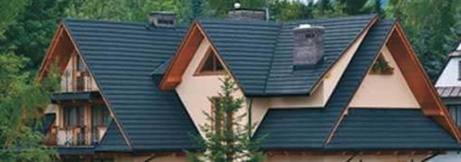 Fot. 1. Dach skośny o dużej liczbie połączeń elementów pionowych ścian i płaszczyzn dachu, w których należy sprawdzić ryzyko wystąpienia zagrzybienia. Archiwum autorów